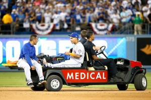 LOS ANGELES, CA - OCTOBER 10:  Ruben Tejada #11 of the New York Mets is carted off the field after sustaining an injury in the seventh inning on slide by Chase Utley #26 of the Los Angeles Dodgers in game two of the National League Division Series at Dodger Stadium on October 10, 2015 in Los Angeles, California.  (Photo by Sean M. Haffey/Getty Images)
