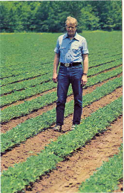 jimmy-carter-in-his-open-neck-blue-work-shirt-blue-jeans-walking-in-the-green-fields-and-red-clay-of-his-rural-georgia-peanut-farm